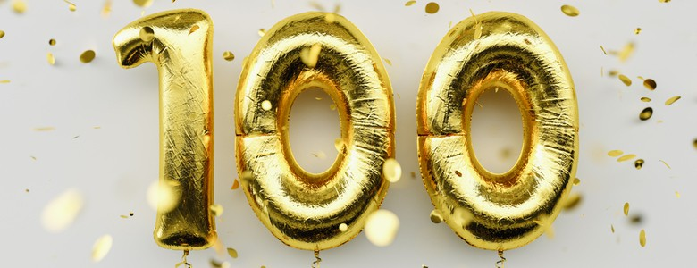 Three gold balloons in a line to form the number 100