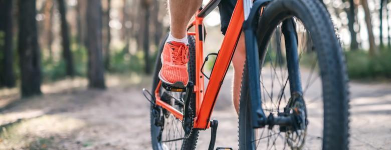 A male cyclist preparing to BMX on a mud path